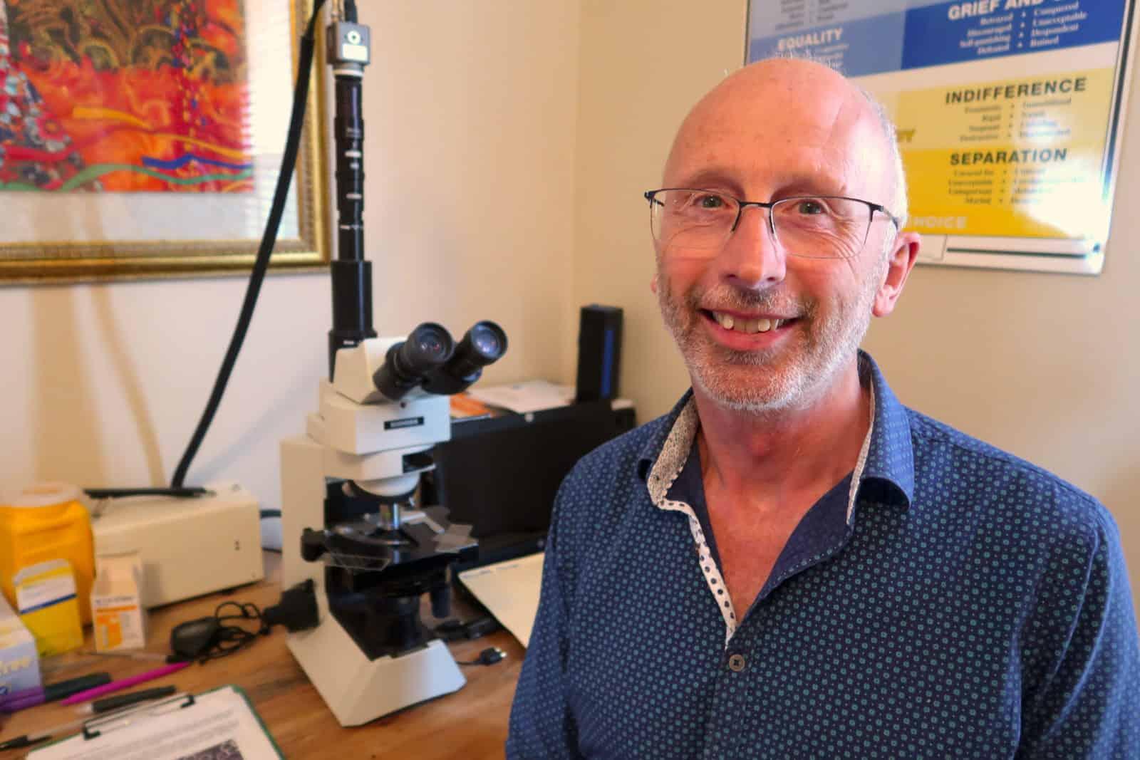 peter at his biomedx desk