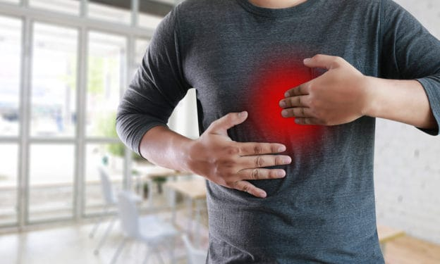 MAN with symptomatic acid reflux suffering from acid reflux