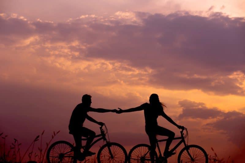 happy couple feeling alive riding bikes